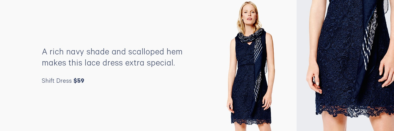 A rich navy shade and scalloped hem makes this lace dress extra special.